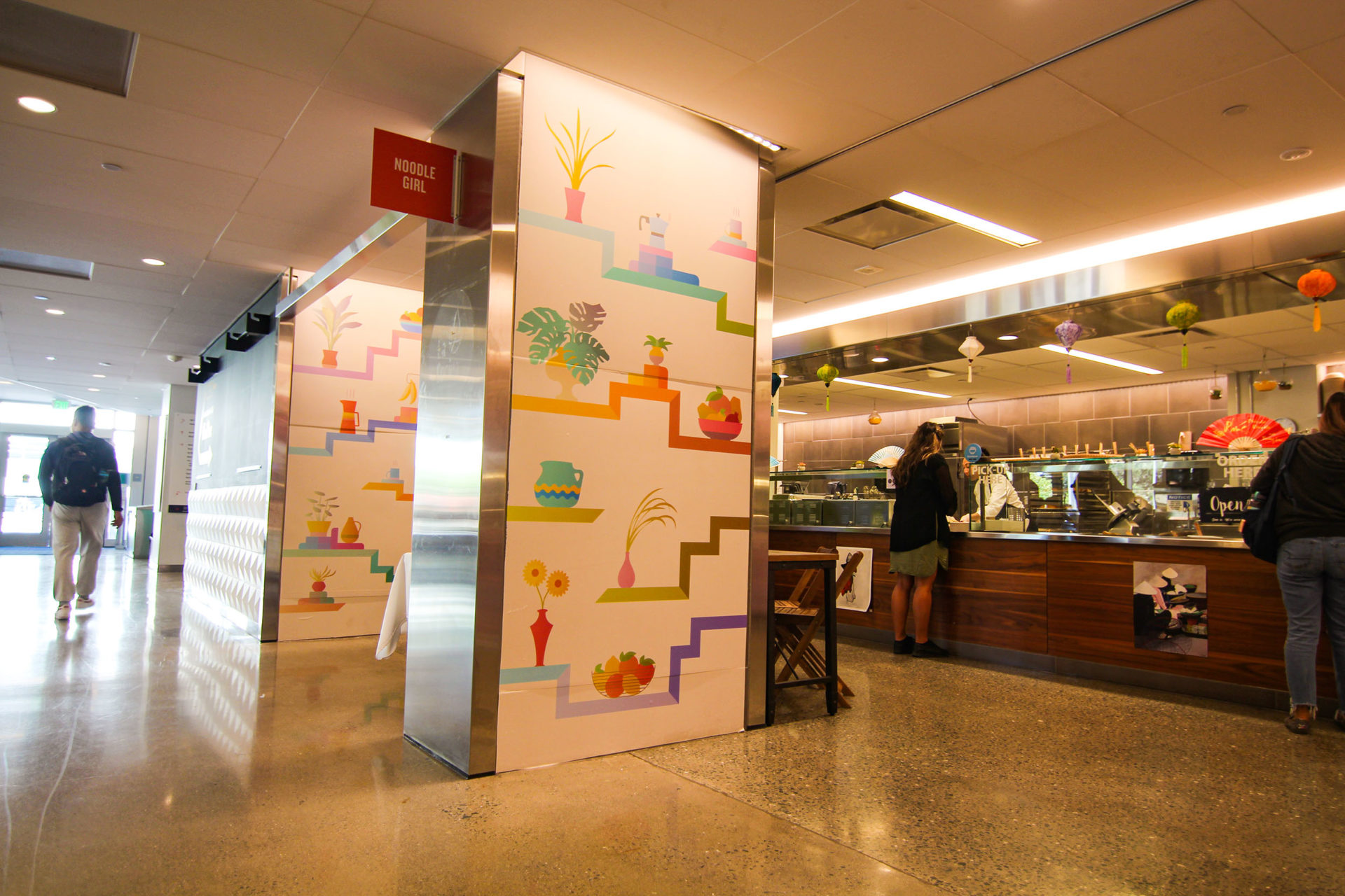 """""""Kitchen Tableau"""" is a series of four murals installed with adhesive vinyl in the dining room of the ASUC Student Union."""